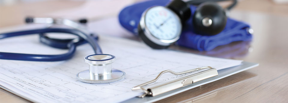 Photo: Stethoscope with a chart showing vital signs